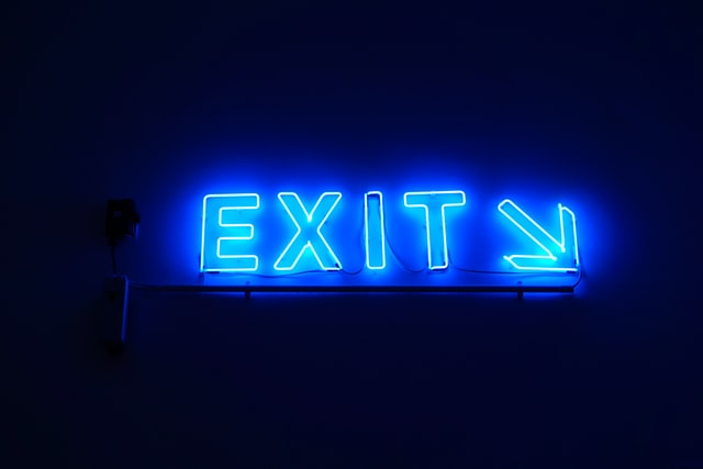 exit sign neon blue with arrow