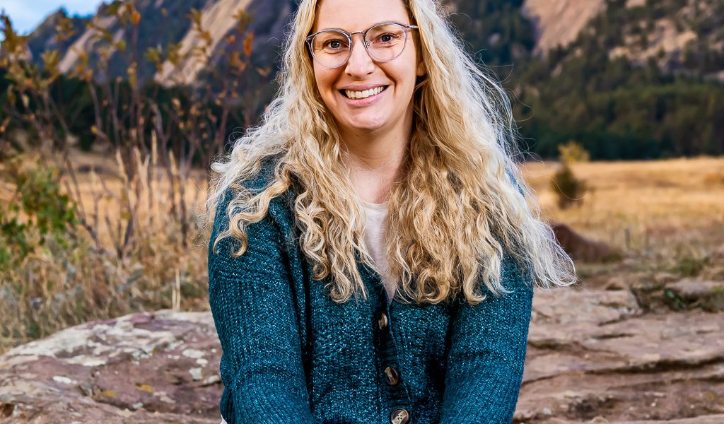 woman blonde hair smiling outside mountains in background stephanie konter o'hara