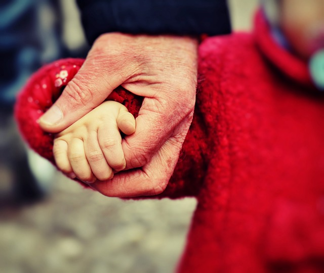 parent holding toddler hand family